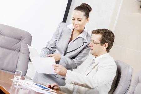 Office Assistant Demonstrating Leadership Skills To Boss